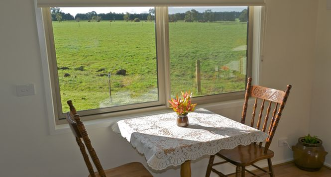 Sit in the sun and enjoy views of the farm at Little Lake Cottage