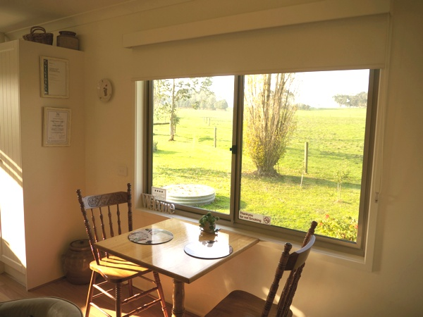 Dining area with views of farmland at Little Lake Cottage Nyora